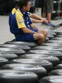 A Honda team member prepares the teams tyres for the weekend