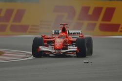Michael Schumacher nearly runs over the wing mirror of Kimi Raikkonen