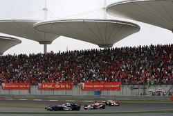 Mark Webber leads Jarno Trulli