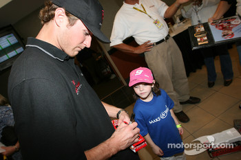 Kasey Kahne signs an autograph for a young fan
