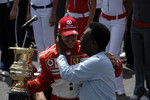 Ceremony for Michael Schumacher's retirement on the starting grid: Michael Schumacher accepts a special trophy from Pel