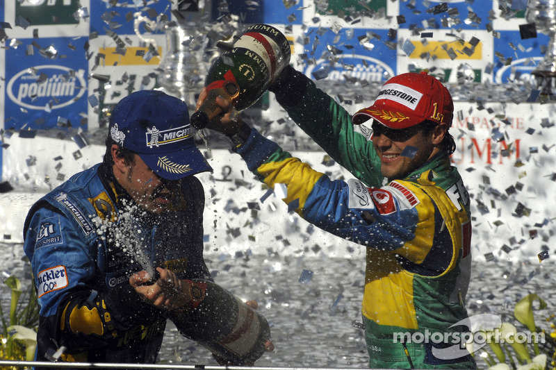 Podium: champagne for Felipe Massa and Fernando Alonso