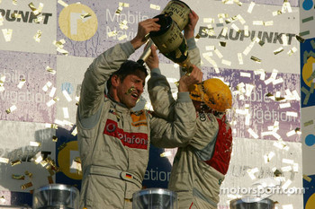 DTM Championship podium 2006: champagne for Bernd Schneider and Tom Kristensen