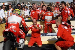 Race winner Troy Bayliss celebrates in parc fermé