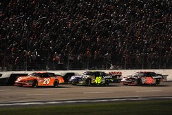 Tony Stewart leads Jimmie Johnson and Kevin Harvick