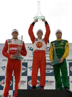 Podium: race winner Sébastien Bourdais with Justin Wilson and Will Power