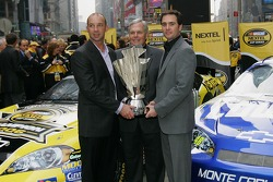Crew chief Chad Knaus, team owner Rick Hendrick and Jimmie Johnson celebrate their championship in Times Square