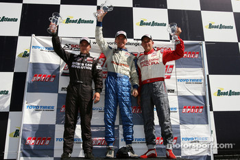 Podium: race winner Randy Pobst with Chip Herr and Eric Curran