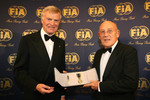 FIA President Max Mosley presents Sir Stirling Moss with the FIA Academy Gold Medal