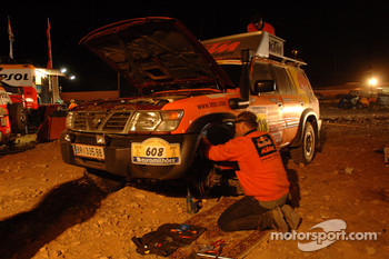Repsol KTM team member at work on an assistance vehicle