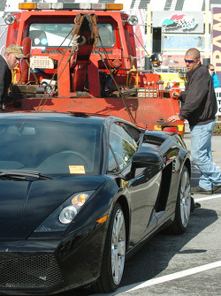 A Lamborghini is towed from a no parking zone
