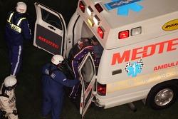 Denny Hamlin climbs aboard the ambulance