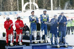 Podium: winners Marcus Gronholm and Timo Rautiainen, second place Sébastien Loeb and Daniel Elena, third place Mikko Hirvonen and Jarmo Lehtinen
