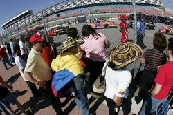 Columbian fans cheer as Juan Pablo Montoya heads to track