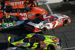 Traffic on pitlane: David Gilliland hits Robby Gordon