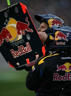 Red Bull Toyota crew members work on their pitboard