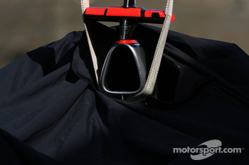 Lewis Hamilton, McLaren Mercedes, car is returned to the pits