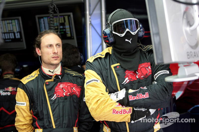 Scuderia Toro Rosso pit crew members in the garage