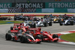 Lewis Hamilton, McLaren Mercedes, MP4-22 and Felipe Massa, Scuderia Ferrari, F2007 at the start of the race