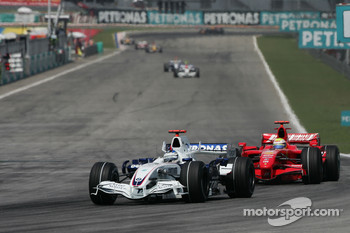 Nick Heidfeld, BMW Sauber F1 Team, F1.07 and Felipe Massa, Scuderia Ferrari, F2007