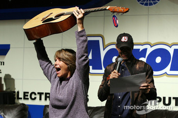 A view of a fan holding up a guitar that she won as a door prize, during the Fandango Exclusive Season Ticket Holders party