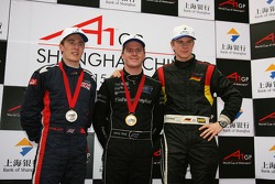 L-R Robbie Kerr, Driver of A1Team Great Britain with Jonny Reid, Driver of A1Team New Zealand and Nico Hulkenberg, Driver of A1Team Germany