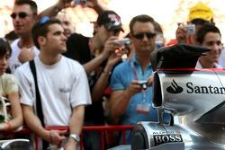 Fans watch, Fernando Alonso, McLaren Mercedes, MP4-22