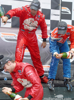 Podium: champagne for Carl Skerlong, Raphael Matos and James Hinchcliffe