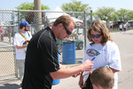 Jaques Lazier signs an autograph