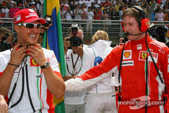 Michael Schumacher, Scuderia Ferrari, Advisor, on the grid with Rob Smedly,, Scuderia Ferrari, Track Engineer of Felipe Massa