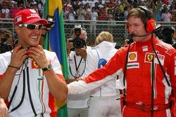 Michael Schumacher, Scuderia Ferrari, Advisor, on the grid with Rob Smedly,, Scuderia Ferrari, Track Engineer of Felipe Massa