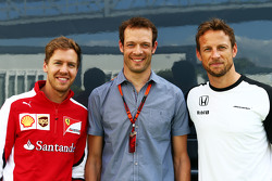 (L to R): Sebastian Vettel, Ferrari with Alexander Wurz, Williams Driver Mentor and Jenson Button, McLaren