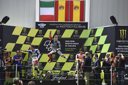 Second place Valentino Rossi and winner Jorge Lorenzo, Yamaha Factory Racing and third place Dani Pedrosa, Repsol Honda Team