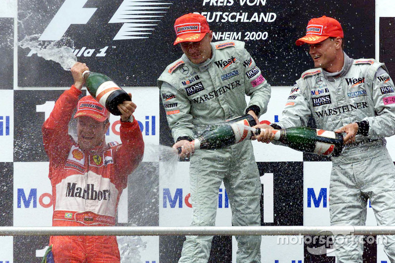 Podium: winner Rubens Barrichello, Ferrari and second place Mika Hakkinen and third place David Coulthard, McLaren