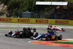 Felipe Nasr, Sauber C34 and Jenson Button, McLaren MP4-30 battle for position