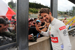 Romain Grosjean, Lotus F1 Team  celebrates his third position with the fans