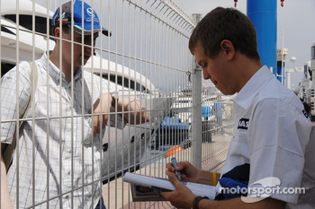 Sebastian Vettel, Test Driver, BMW Sauber F1 Team, gives autographs