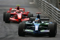 Jenson Button, Honda Racing F1 Team, RA107 and Kimi Raikkonen, Scuderia Ferrari, F2007