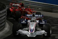 Nick Heidfeld, BMW Sauber F1 Team, F1.07 leads Kimi Raikkonen, Scuderia Ferrari, F2007