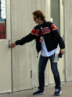 Jarno Trulli, Toyota Racing arrives at the track and reads The Red Bulletin