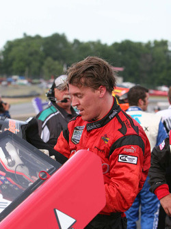 Alex Gurney climbs from the winning car