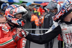 Race winner Casey Stoner is congratulated by second place Colin Edwards