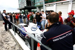BMW Sauber F1 Team, F1.07 in the pitlane with fans