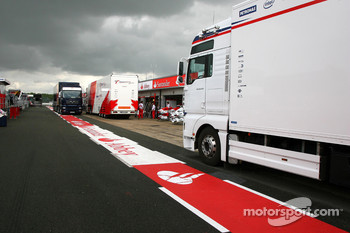 Teams set up in the pitlane