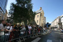 Fans wait for the start of the parade