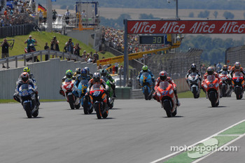 Start: Marco Melandri, Dani Pedrosa and Casey Stoner battle for the lead