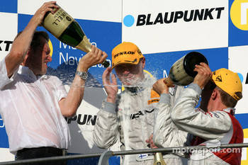 Podium: Hans-Jürgen Mattheis, Team Manager HWA and Mattias Ekström, Audi Sport Team Abt Sportsline, give Mika Hakkinen, Team HWA AMG Mercedes a champagne shower