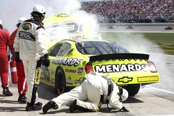 Paul Menards brings in his Menards Chevrolet into the pits