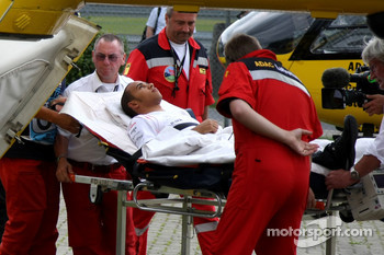 Lewis Hamilton, McLaren Mercedes is taken to a helicopter for health checks after crashing