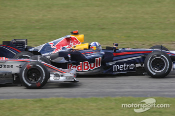 Lewis Hamilton, McLaren Mercedes and David Coulthard, Red Bull Racing before the entrance of the pit lane / last corner
